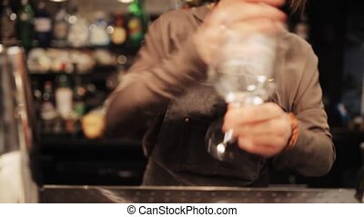 barmaid preparing cocktail at bar