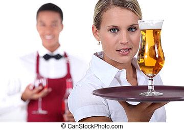 Barman and waitress