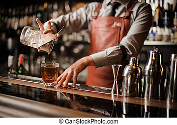 Barman making alcohol cocktail. No face