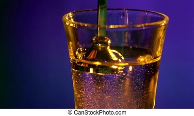 Barman pouring last layer of alcohol liquid, into a glass, shots, slow motion, close up, cam moves upwards