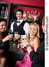 Barman prepare cocktails friends drinking at bar - Cheerful...