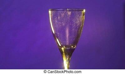 Barman prepares cocktail drink using ice in porto glass,...