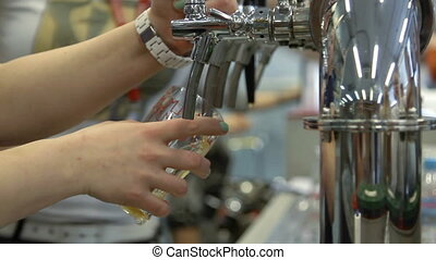 Barman pulling a pint of beer - Moscow, Russian Federation -...
