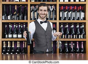 barman, vasthouden, rode wijn, fles, en, glas, in, winkel