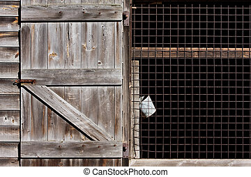 Barn and Bucket - An old barn with a hanging bucket in...
