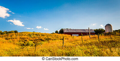 Barn and fences on a farm field in the Shenandoah Valley, Virginia.