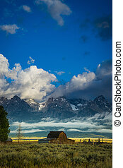 Barn and fields of grass and sagebrush, Grand Teton National Park, Wyoming