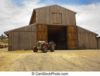 barn and tracktor - An old wooden unpainted barn, doors open...