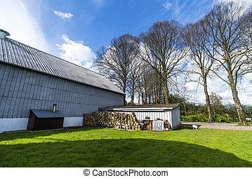 Barn at a farm with a small shed