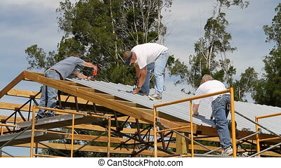 Barn Construction Crew - Crew of construction workers use...