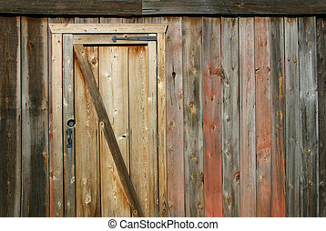 Barn door - A wooden barn with interesting colors and...