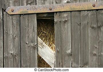 Barn gate - Broken barn gate with straw