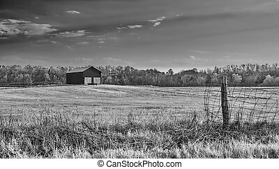 Barn in a Field with Fence