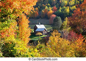 Barn in autumn tree frame