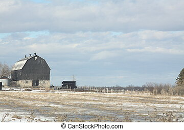 Barn in Snowy Field