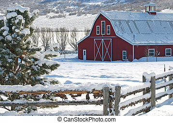 Red barn in the country with fresh snow.