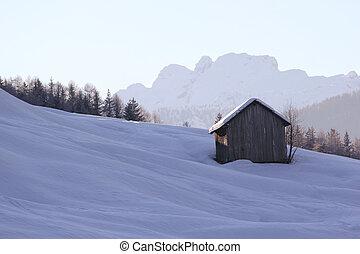 Barn in winter scene.