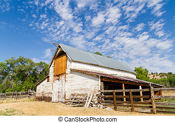 Barn - Old white barn with farm yard.