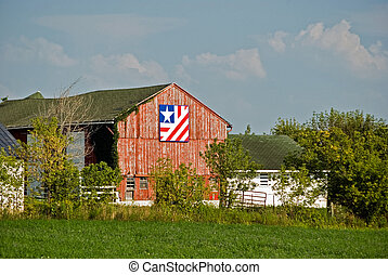 Barn Quilt - Barn quilt design on weathered barn.