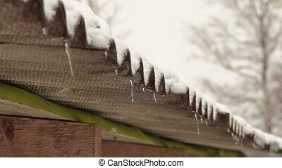 Barn roof with first icicles