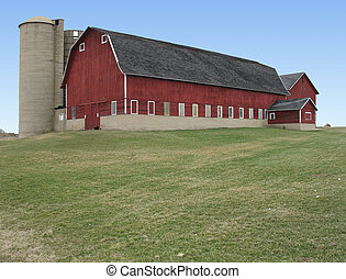 barn - big red barn with grassy area in front and blue sky