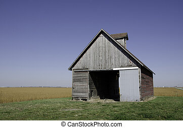 Barn with bean field and blue sky