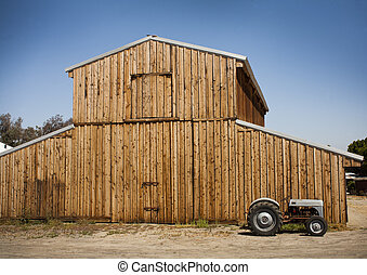 barn with old tractor - Wooden barn with metal roof with an...