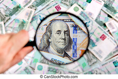 barometr, zvetšovací sklo, peníze