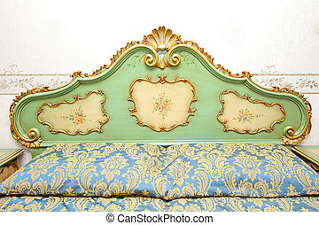 Antique baroque bed headboard with floral ornaments