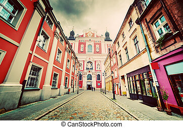 Baroque Collegiate Church in Poznan, Posen, Poland. Old town street. Vintage