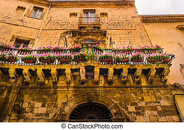 Baroque facede decorated with flowers in Italy.