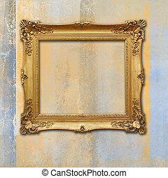 baroque golden frame on a grunge faded texture - vintage...