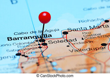 Photo of pinned Barranquilla on a map of South America. May be used as illustration for traveling theme.