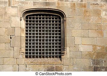 Barred ancient window in Barcelona, Spain