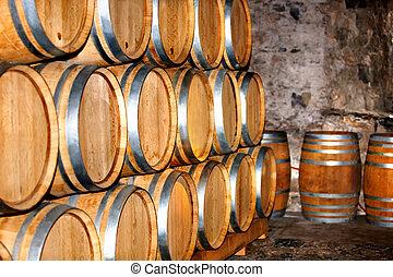 Barrel of wine in winery. - Barrel of wine in old winery.