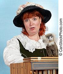 A woman barrel organ player emotional singing