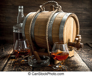 Barrel with French cognac, glasses and a cigar.