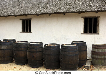 Barrels by an old house