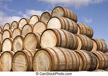 Barrels in the distillery - american oak bourbon barrels at...