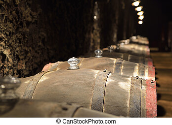Barrels of wine in a cellar