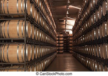 Barrels of wine in an old cellar