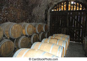 barrels of wine in wine cellar casks