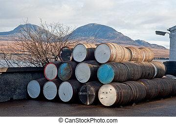 Barrels - Stack of whisky barrels outside of distillery