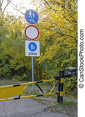Barrier and road signs. Pedestrian area and bike path. - ...