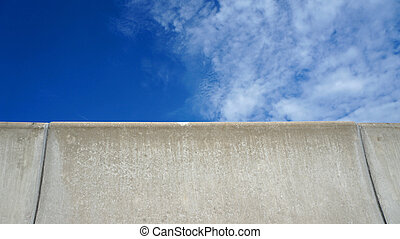 barrier fence on the highway with blue sky