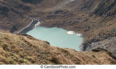 video footage of a barrier lake near the mountain Gro?glockner in Austria in the alps