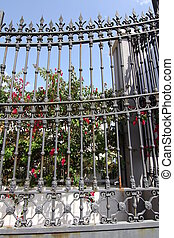 bars and decorated in an old iron gate