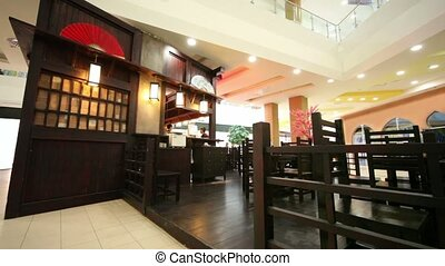 Bartender and waiter in few empty restaurant in eastern...