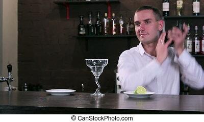 Bartender at work behind the bar
