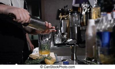 Bartender is making cocktail. prepares a refreshing drink...
